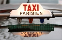 The top of a taxi is seen in downtown Paris