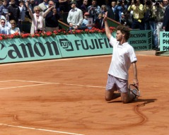 GUSTAVO KUERTEN OF BRAZIL CELEBRATES AT THE FRENCH TENNIS OPEN.